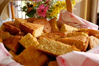 Cornbreads, sliced, in basket, flowers