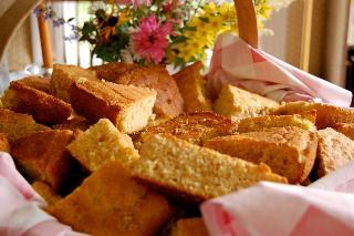 Cornbreads, sliced, in basket, flowers